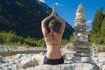 Thumbnail Woman doing yoga next to a stone pyramid, Valle Verzasca, Ticino, Switzerland, Europe