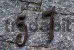 Thumbnail House number quot57quot, metal cipher on a stone wall
