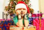 Thumbnail boy with Christmas presents under Christmas tree