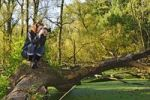Thumbnail Photographer on a fallen tree over a swamp
