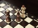 Thumbnail Checkmate situation on a chessboard