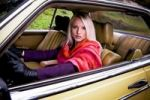 Thumbnail Young woman in a vintage Mercedes Benz