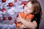 Thumbnail Girl hugging a Christmas present