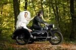 Thumbnail Bride and groom driving to their wedding in a motorcycle with sidecar