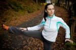 Thumbnail Young woman doing warming up exercises before jogging