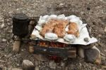 Thumbnail Cooking on a camp fire, BBQ, steaks and baked potatoes, tea cattle, upper Liard River, Yukon Territory, Canada