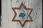 Thumbnail Coloured carved eye of God in a hexagonal star on a wooden beam, Fischbachau, Bavaria, Germany, Europe