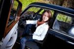 Thumbnail Young woman in a vintage MB vehicle