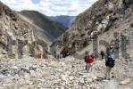 Thumbnail trekking group descends through rocky gorge from Chitu-La Pass Tibet China