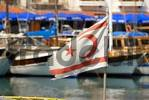 Thumbnail Flag of North Cyprus waves in the port of Girne Kyrenia North Cyprus