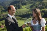 Thumbnail Father and daughter clinking their wine glasses, Southern Styria, Styria, Austria, Europe