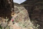 Thumbnail Woman carrying a backpack on a hiking trail, Barranco de Guarimiar near Alajeró, La Gomera, Canary Islands, Spain, Europe