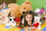 Thumbnail Girl, 4 years, with lots of plush toys