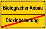 "Thumbnail City limits sign ""Biologischer Anbau"", German for ""organic farming"" and ""Dioxinbelastung"", German for ""dioxin contamination"", symbolic image for contaminate"