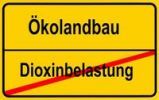 "Thumbnail City limits sign, ""Oekolandbau"", German for ""organic farming"" and ""Dioxinbelastung"", German for ""dioxin contamination"", symbolic image for contaminated food"