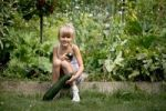 Thumbnail Young girl working in the garden
