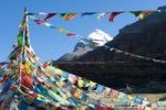 Thumbnail Tibetan Buddhism, Tarboche, a flagpole with colourful prayer flags, in front of the snow-covered holy Mount Kailash, south side, Gang Rinpoche, pilgrimage trail, Kora, Ngari, Gang-Tise Mountains,