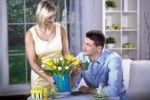 Thumbnail Young couple at a table with tulips in a vase and Easter eggs