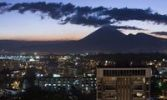Thumbnail Downtown zone 10 at night with volcanoes in the back, Guatemala city, Guatemala, Central America