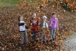 Thumbnail Children playing with leaves in autumn