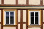 Thumbnail Half-timbered house with yellow and white windows