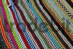 Thumbnail sale stand with colourful pearl necklets, weekly market, Altea, Costa Blanca, Spain