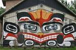 Thumbnail a wooden building is painted in the style of the native people of Alaska USA