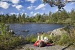 Thumbnail Mother and daughter resting on a big rock at St. Hindsjoen lake near Alsterbro, South Sweden, Scandinavia, Europe