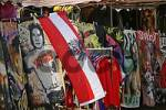 Thumbnail stall selling flags and clothing on market Naschmarkt Vienna Austria