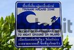 Thumbnail Tsunami hazard zone sign in a shrub at the beach Koh Libong Thailand