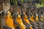 Thumbnail Many Buddha figures in a row with orange cloth Wat Yai Chai Mongkol Ayutthaya Thailand