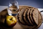 Thumbnail Glass of water, an apple and slices of bread