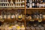 Thumbnail rack with pecorino, honey and grappa in a delicatessen in Pienza, Tuscany, Italy