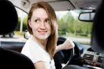Thumbnail Young woman driving a car