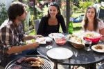 Thumbnail Young people barbecuing outside
