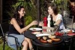 Thumbnail Two young women barbecuing outside
