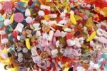 Thumbnail Clear plastic bags with a variety of fruit gums, marshmallows, candies, lollipops, cookies and gummy bears