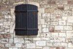Thumbnail Shuttered window in a castle wall