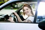 Thumbnail A young woman driving a car