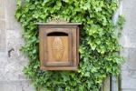 Thumbnail Carved wooden mailbox with ivy growing on a stone wall, Dun-le-Palestel, La Creuse, Limousin, France, Europe