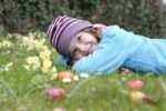 Thumbnail Girl with easter eggs in a spring meadow