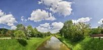 Thumbnail Clouds over the old Ludwig Canal or Ludwig-Donau-Main-Kanal with flowering fruit trees, Naturpark Altmuehltal nature forest, Bavaria, Germany, Europe