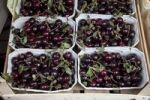 Thumbnail Baskets of cherries at a market stall