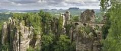 Thumbnail View of the rocks of the Bastei and the Basteibruecke bridge, behind Mt. Lilienstein, Elbe Sandstone Mountains, Saxony, Germany, Europe