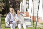 Thumbnail Elderly Asian couple sitting on a swing in the garden, China, Asia
