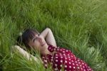 Thumbnail Young woman, 25, lying in a meadow