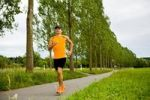 Thumbnail Athletic young man jogging along a tree-lined road near Coburg, Bavaria, Germany, Europe