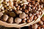 Thumbnail Wicker basket with mixed nuts, Walnuts (Juglans regia), Peanuts (Arachis hypogaea) and Hazelnuts (Corylus avellana)