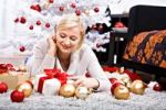 Thumbnail Young woman lying amidst Christmas decorations