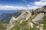 Thumbnail Hiker on the ridge of Spitzer Kornigl to Kleiner Kornigl, Ultental valley, Ulten in spring, South Tyrol, Italy, Europe